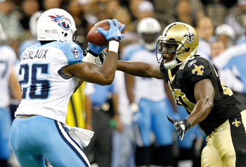 NEW ORLEANS, LA - SEPTEMBER 01: Tennesse Titans Jordan Babineaux #26 intercepts a pass against the New Orleans Saints during their pre season game at Louisiana Superdome on September 1, 2011 in New Orleans, Louisiana (Photo by Sean Gardner/ Getty Images)