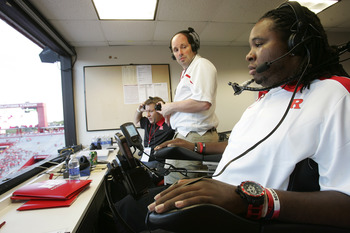 PISCATAWAY, NJ - SEPTEMBER 1: Former Rutgers football player Eric LeGrand (R), works as an analyst for the Rutgers Radio Network before the start a college football game between North Carolina Central and Rutgers on September 1, 2011 at High Point Solutio