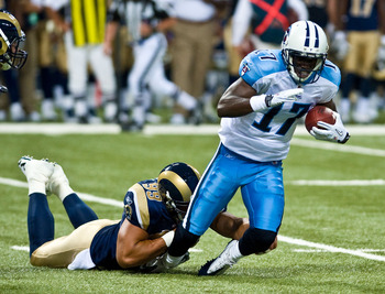 ST. LOUIS, MO - AUGUST 20:  Damian Williams #17 of the Tennessee Titans is tackled by C.J. Ah You #99 of the St. Louis Rams at the Edward Jones Dome on August 20, 2011 in St. Louis, Missouri.  (Photo by Ed Szczepanski/Getty Images)