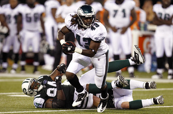 EAST RUTHERFORD, NJ - SEPTEMBER 01: Graig Cooper #43 of the Philadelphia Eagles runs away from  Marcus Dixon #94 of the New York Jets during their pre-season game at MetLife Stadium on September 1, 2011 in East Rutherford, New Jersey.  (Photo by Jeff Zele