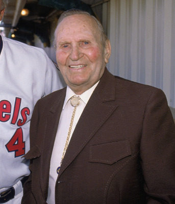 ANAHEIM, CA 1990:  Owner of the California Angels Gene Autry and Angels' manager Doug Rader #4 stand for a photo graph prior to a game at Anaheim Stadium during the 1990 season in Anaheim, California.   (Photo by Ken Levine/Getty Images)