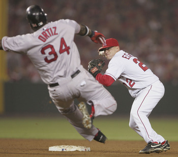 ANAHEIM, CA - OCTOBER 6: David Eckstein #22 of the Anaheim Angels throws David Ortiz #34 of the Boston Red Sox out at second during a double play in the sixth inning of the American League Division Series, Game 2 October 6, 2004 at Angels Stadium in Anahe
