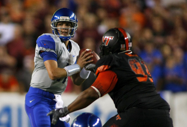LANDOVER, MD - SEPTEMBER 06:  Quarterback Kellen Moore #11 of the Boise State Broncos prepares to pass as defensive tackle Kwamaine Battle #93 of the Virginia Tech Hokies defends at FedExField on September 6, 2010 in Landover, Maryland.  (Photo by Geoff B
