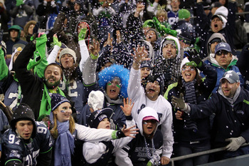 SEATTLE, WA - JANUARY 02:  Fans of the Seattle Seahawks celebrate advancing to the playoffs after defeating the St. Louis Rams 16-6 at Qwest Field on January 2, 2011 in Seattle, Washington.  (Photo by Otto Greule Jr/Getty Images)