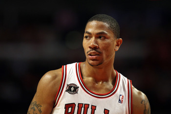 CHICAGO, IL - MAY 26:  Derrick Rose #1 of the Chicago Bulls looks on against the Miami Heat in Game Five of the Eastern Conference Finals during the 2011 NBA Playoffs on May 26, 2011 at the United Center in Chicago, Illinois. The Heat won 83-80. NOTE TO U