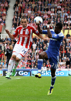 STOKE ON TRENT, ENGLAND - AUGUST 14:  Matthew Etherington of Stoke and Salomon Kalou of Chelsea compete for a header during the Barclays Premier League match between Stoke City and Chelsea at the Britannia Stadium on August 14, 2011 in Stoke on Trent, Eng