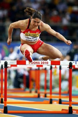 DOHA, QATAR - MARCH 13:  Priscilla Lopes-Schliep of Canada competes in the Womens 60m Semi Final Hurdles during Day 2 of the IAAF World Indoor Championships at the Aspire Dome on March 13, 2010 in Doha, Qatar.  (Photo by Michael Steele/Getty Images)
