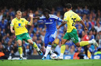 LONDON, ENGLAND - AUGUST 27:  Romelu Lukaku of Chelsea is held up by Ritchie De Laet (L) of Norwich City during the Barclays Premier League match between Chelsea and Norwich City at Stamford Bridge on August 27, 2011 in London, England.  (Photo by Shaun B