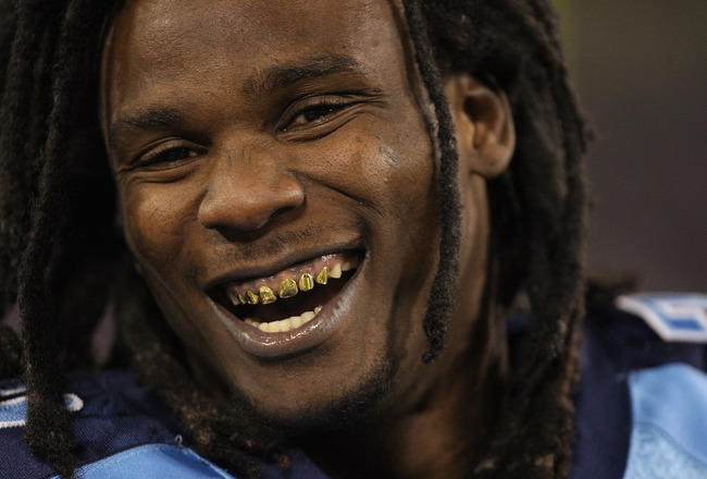 NASHVILLE, TN - NOVEMBER 01:  Chris Johnson #28 of the Tennessee Titans shows off gold teeth while smiling as he reacts to his teams 30-13 victory over the Jacksonville Jaguars at LP Field on November 1, 2009 in Nashville, Tennessee.  (Photo by Streeter L