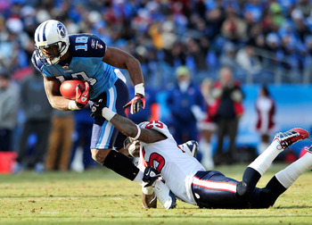 NASHVILLE, TN - DECEMBER 19:  Kenny Britt #18 of the Tennessee Titans breaks away from Kareem Jackson #25 of the Houston Texans at LP Field on December 19, 2010 in Nashville, Tennessee. The Titans defeated the Texans, 31-17.  (Photo by Grant Halverson/Get