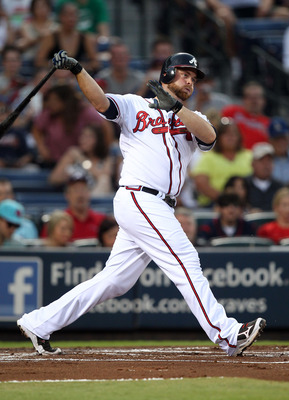 ATLANTA, GA - SEPTEMBER 02:  Catcher Brian McCann #16 of the Atlanta Braves follow through on a swing during the game against the Los Angeles Dodgers at Turner Field on September 2, 2011 in Atlanta, Georgia.  (Photo by Mike Zarrilli/Getty Images)