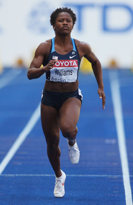 BERLIN - AUGUST 16: Lauryn Williams of United States competes in the women's 100 Metres Heats during day two of the 12th IAAF World Athletics Championships at the Olympic Stadium on August 16, 2009 in Berlin, Germany.  (Photo by Andy Lyons/Getty Images)