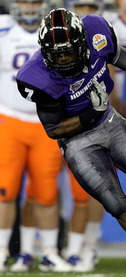 GLENDALE, AZ - JANUARY 04:  Greg McCoy #7 of the TCU Horned Frogs drops the ball during the opening kick return as Byron Hout #94 of the Boise State Broncos grabs at his under-shirt in the first quarter during the Tostitos Fiesta Bowl at the Universtity o