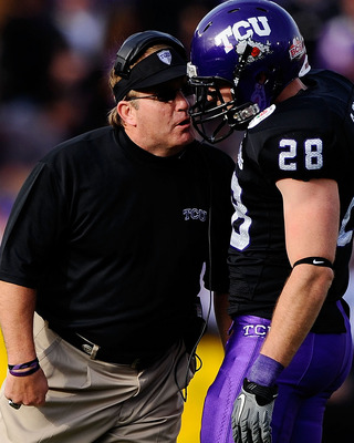 PASADENA, CA - JANUARY 01:  Head coach Gary Patterson of the TCU Horned Frogs talks with safety Colin Jones #28 on the field during their game against the Wisconsin Badgers in the 97th Rose Bowl game on January 1, 2011 in Pasadena, California.  (Photo by