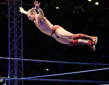 DURBAN, SOUTH AFRICA - JULY 08:  WWE Superstar Daniel Bryan flys off the ropes during the WWE Smackdown Live Tour at Westridge Park Tennis Stadium on July 08, 2011 in Durban, South Africa.  (Photo by Steve Haag/Gallo Images/Getty Images)