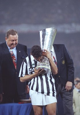 19 May 1993:  Roberto Baggio of Juventus kisses the cup after his team wins the UEFA Cup final second leg against Borussia Dortmund at the Delle Alpi Stadium in Turin, Italy. Juventus won the match 3-0. \ Mandatory Credit: Shaun  Botterill/Allsport