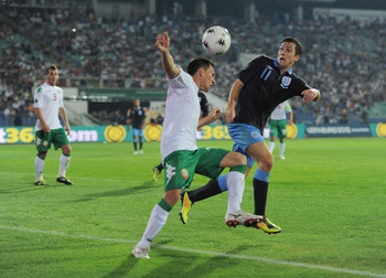 SOFIA, BULGARIA - SEPTEMBER 02: Stewart Downing of England in action with Zhivko Milanov of Bulgaria during the UEFA EURO 2012 group G qualifying match between Bulgaria and England at the Vasil Levski National Stadium on September 2, 2011 in Sofia, Bulgar