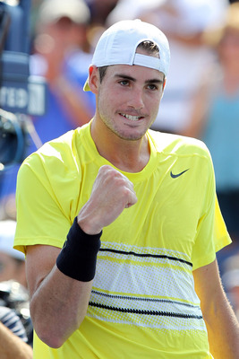 NEW YORK, NY - SEPTEMBER 02:  John Isner of the United States celebrates after defeating Robby Ginepri of the United States during Day Five of the 2011 US Open at the USTA Billie Jean King National Tennis Center on September 2, 2011 in the Flushing neighb