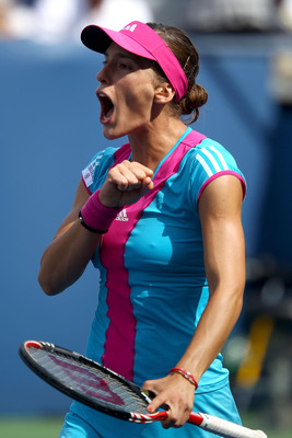 NEW YORK, NY - SEPTEMBER 01:  Andrea Petkovic of Germany celebrates match point against Jie Zheng of China during Day Four of the 2011 US Open at the USTA Billie Jean King National Tennis Center on September 1, 2011 in the Flushing neighborhood of the Que