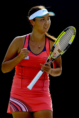 MASON, OH - AUGUST 16:  Shuai Peng of China celebrates a point against Gisella Dulko of Argentina during the Western & Southern Open at the  Lindner Family Tennis Center on August 16, 2011 in Mason, Ohio.  (Photo by Matthew Stockman/Getty Images)