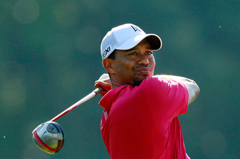 JOHNS CREEK, GA - AUGUST 11:  Tiger Woods hits a tee shot on the 14th hole during the first round of the 93rd PGA Championship at the Atlanta Athletic Club on August 11, 2011 in Johns Creek, Georgia.  (Photo by Kevin C. Cox/Getty Images)