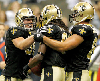 NEW ORLEANS, LA - SEPTEMBER 01: Montez Billings # 89 of the New Orleans Saints celebrates with Korey Hall #35 and #82 Tyler Lorenzen after scoring a touchdown against the Tennessee Titans during their pre season game at Louisiana Superdome on September 1,