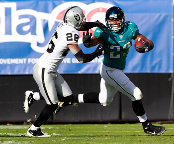 JACKSONVILLE, FL - DECEMBER 12:  Rashad Jennings #23 of the Jacksonville Jaguars rushes against Stanford Routt #26 of the Oakland Raiders during the game at EverBank Field on December 12, 2010 in Jacksonville, Florida.  (Photo by Sam Greenwood/Getty Image