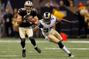 NEW ORLEANS, LA - DECEMBER 12:  Lance Moore #16 of the New Orleans Saints avoids a tackle by James Butler #37 of the St. Louis Rams at the Louisiana Superdome on December 12, 2010 in New Orleans, Louisiana. The Saints defeated the Rams 31-13.  (Photo by C
