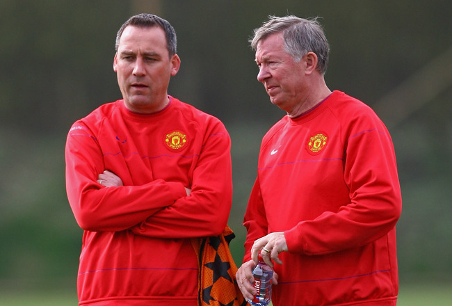 MANCHESTER, ENGLAND - APRIL 06:  Sir Alex Ferguson, manager of Manchester United, talks with Rene Meulensteen, first team coach, during a training session held at the Carrington Training Complex on April 6, 2009 in Manchester, England.  (Photo by Alex Liv