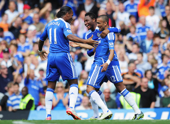 LONDON, ENGLAND - AUGUST 27:  Jose Bosingwa of Chelsea celebrates his opening goal with team mates Didier Drogba and Mikel during the Barclays Premier League match between Chelsea and Norwich City at Stamford Bridge on August 27, 2011 in London, England.