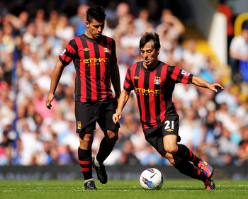 LONDON, ENGLAND - AUGUST 28:  David Silva (R) of Manchester City controls the ball as teammate Sergio Aguero looks on during the Barclays Premier League match between Tottenham Hotspur and Manchester City at White Hart Lane on August 28, 2011 in London, E