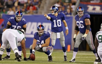 EAST RUTHERFORD, NJ - AUGUST 29:  Eli Manning #10,  Chris Snee #76,  David Baas #64 and  David Diehl #66 of the New York Giants in action against the New York Jets during their pre season game on August 29, 2011 at MetLife Stadium in East Rutherford, New