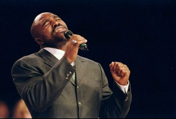 6 Nov 1997:  Evander Holyfield sings at the Holy War Invasion Church Revival at Cashman Field in Las Vegas, Nevada. Mandatory Credit: Al Bello  /Allsport