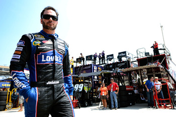HAMPTON, GA - SEPTEMBER 03:  Jimmie Johnson, driver of the #48 Lowe's Chevrolet, looks on during practice for the NASCAR Sprint Cup Series AdvoCare 500 at Atlanta Motor Speedway on September 3, 2011 in Hampton, Georgia.  (Photo by Jared C. Tilton/Getty Im
