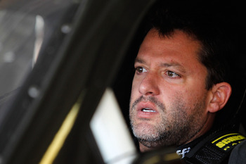 HAMPTON, GA - SEPTEMBER 03:  Tony Stewart, driver of the #14 Office Depot/Mobil 1 Chevrolet, sits in his car during practice for the NASCAR Sprint Cup Series AdvoCare 500 at Atlanta Motor Speedway on September 3, 2011 in Hampton, Georgia.  (Photo by Todd