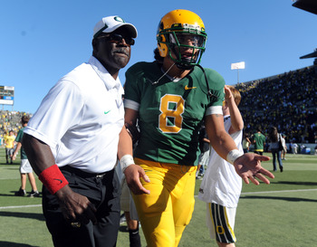 Oregon's running back coach Gary Campbell with fromer Ducks' QB Jeremiah Masoli during the 2009 season