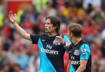 MANCHESTER, ENGLAND - AUGUST 28:  Tomas Rosicky and Andrey Arshavin of Arsenal look dejected during the Barclays Premier League match between Manchester United and Arsenal at Old Trafford on August 28, 2011 in Manchester, England.  (Photo by Alex Livesey/