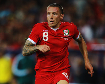CARDIFF, WALES - SEPTEMBER 02:  Craig Bellamy of Wales in action during the UEFA EURO 2012 group G qualifying match between Wales and Montenegro at the Cardiff City Stadium on September 2, 2011 in Cardiff, Wales.  (Photo by Paul Gilham/Getty Images)