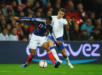 LONDON, ENGLAND - NOVEMBER 17:  Yann M'Vila (L) of France holds off the challenge of Jordan Henderson (R) of England during the international friendly match between England and France at Wembley Stadium on November 17, 2010 in London, England.  (Photo by