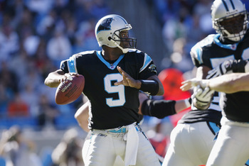 CHARLOTTE, NC - NOVEMBER 24:  Quarterback Rodney Peete #9 of the Carolina Panthers prepares to pass during the NFL game against the Atlanta Falcons at Ericsson Stadium on November 24, 2002 in Charlotte, North Carolina. The Falcons defeated the Panthers 41