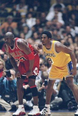 1 Feb 1998:  Guard Michael Jordan of the Chicago Bulls (left) and guard Kobe Bryant of the Los Angeles Lakers look on during a game at the Great Western Forum in Inglewood, California.  The Lakers won the game, 112-87. Mandatory Credit: Jed Jacobsohn  /Al