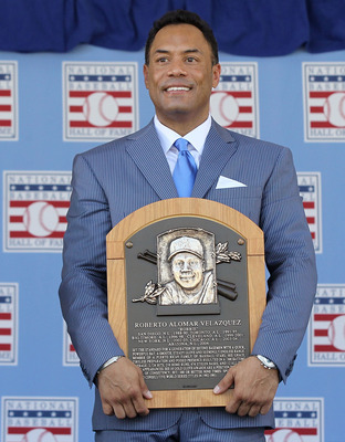 COOPERSTOWN, NY - JULY 24:  Roberto Alomar poses with his plaques at Clark Sports Center during the Baseball Hall of Fame induction ceremony on July 24, 2011 in Cooperstown, New York. In 17 major league seasons, Alomar tallied 2,724 hits, 210 home runs, 1