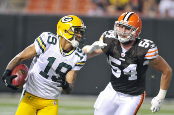 CLEVELAND, OH - AUGUST 13: Ben Jacobs #54 of the Cleveland Browns pursues Diondre Borel #19 of the Green Bay Packers during the third quarter at Cleveland Browns Stadium on August 13, 2011 in Cleveland, Ohio. The Browns defeated the Packers 27-17. (Photo