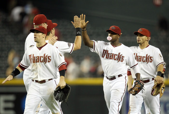 PHOENIX, AZ - AUGUST 30:  Justin Upton #10 of the Arizona Diamondbacks high fives teammates after defeating the Colorado Rockies in the Major League Baseball game at Chase Field on August 30, 2011 in Phoenix, Arizona. The Diamondbacks defeated the Rockies