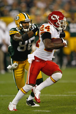 GREEN BAY, WI - SEPTEMBER 1:  Brandon Flowers #24 of the Kansas City Chiefs runs with the football as he is grabbed by the jersey by Tori Gurly #86 of the Green Bay Packers during a preseason game at Lambeau Field on September 1, 2011 in Green Bay, Wiscon