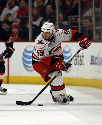 CHICAGO, IL - MARCH 04: Chad LaRose #59 of the Carolina Hurricanes looks to pass the puck against the Chicago Blackhawks at the United Center on March 4, 2011 in Chicago, Illinois. The Blackhawks defeated the Hurricanes 5-2. (Photo by Jonathan Daniel/Gett