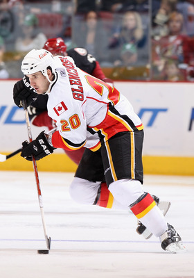 GLENDALE, AZ - MARCH 10:  Curtis Glencross #20 of the Calgary Flames skates with the puck during the NHL game against the Phoenix Coyotes at Jobing.com Arena on March 10, 2011 in Glendale, Arizona.  The Coyotes defeated the Flames 3-0.  (Photo by Christia
