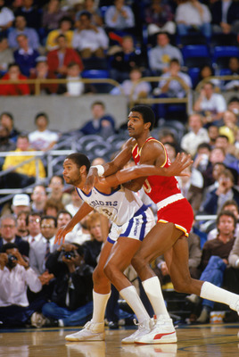 1987:  Ralph Sampson #50 of the Houston Rockets is guarded by Joe Barry Carroll #2 of the Golden State Warriors during a game in the1987-88 season. NOTE TO USER: User expressly acknowledges and agrees that, by downloading and/or using this Photograph, Use