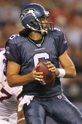 SEATTLE - AUGUST 20:  Quarterback Charlie Whitehurst #6 of the Seattle Seahawks looks to pass against the Minnesota Vikings at CenturyLink Field on August 20, 2011 in Seattle, Washington. (Photo by Otto Greule Jr/Getty Images)