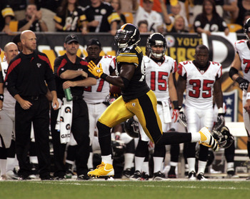 PITTSBURGH, PA - AUGUST 27:  Lawrence Timmons #94 of the Pittsburgh Steelers runs after catching an interception against the Atlanta Falcons during a pre-season game on August 27, 2011 at Heinz Field in Pittsburgh, Pennsylvania.  (Photo by Justin K. Aller